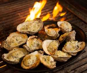 Charbroiled oysters with parmesan cheese and butter garlic broth.
